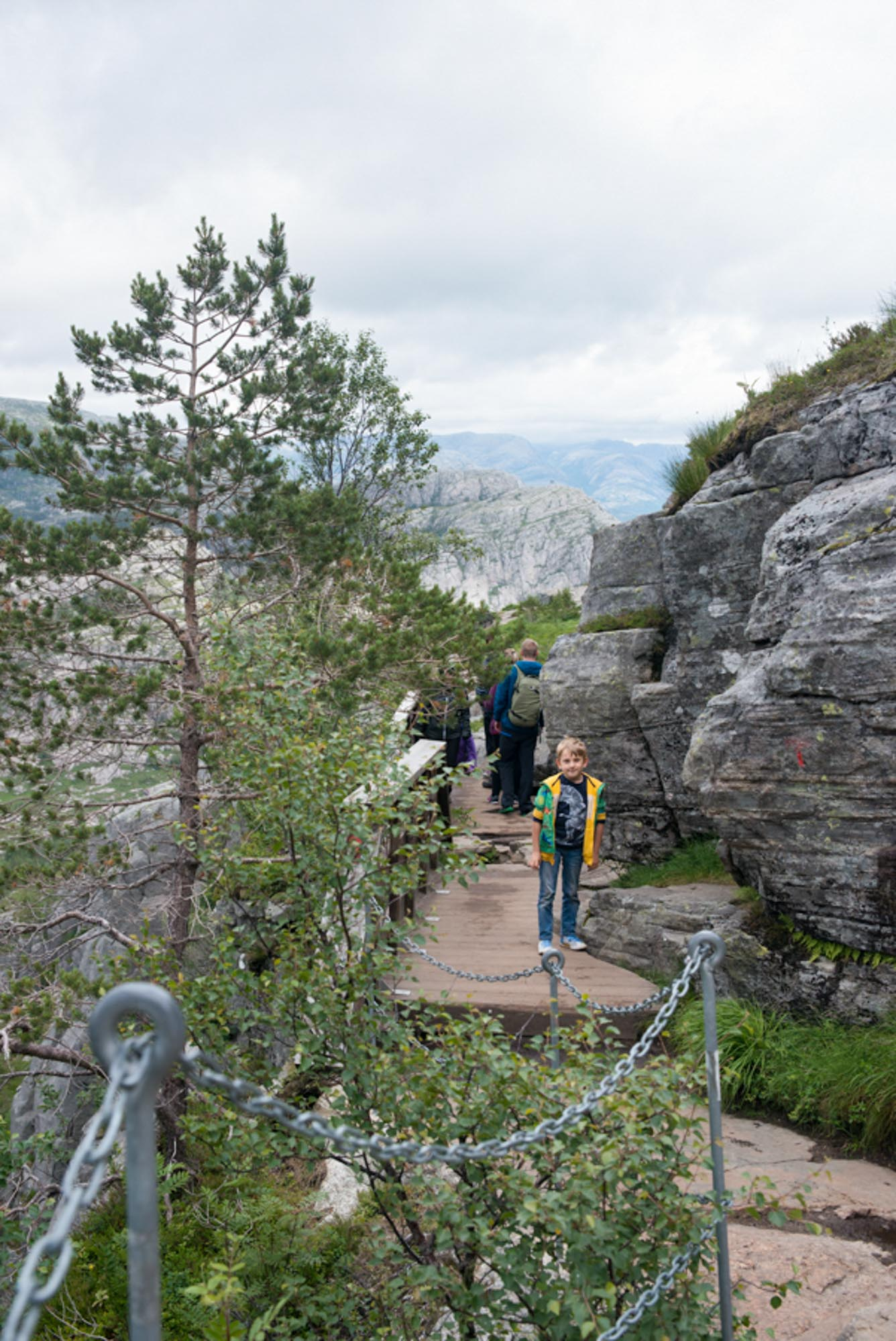 boy hiking preikestolen