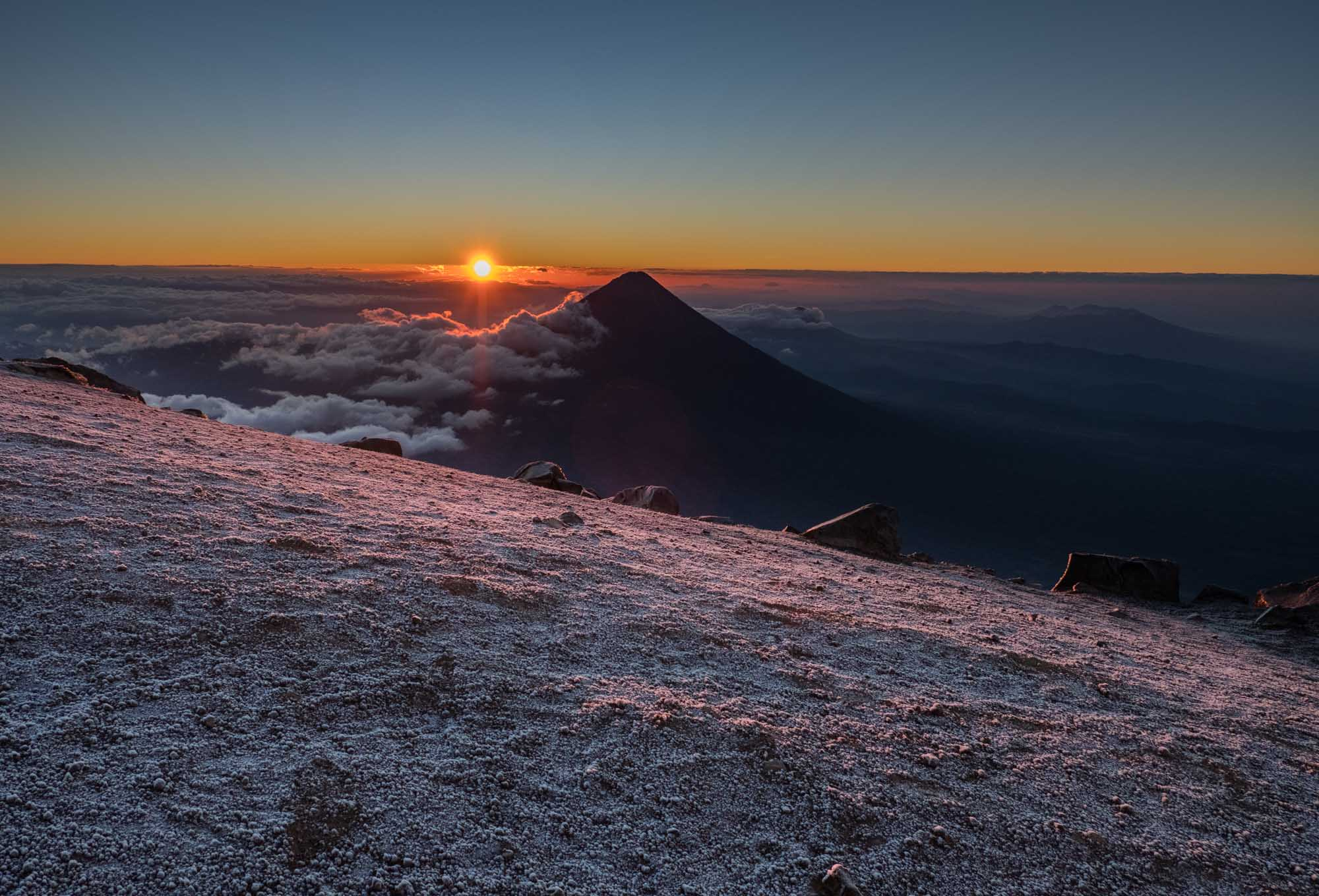 The sun rising behind Volcan Agua
