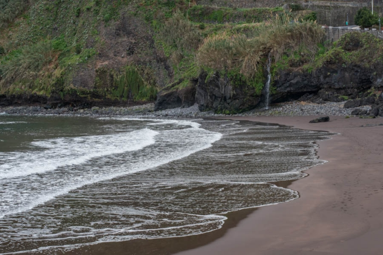 The beach with its black sands