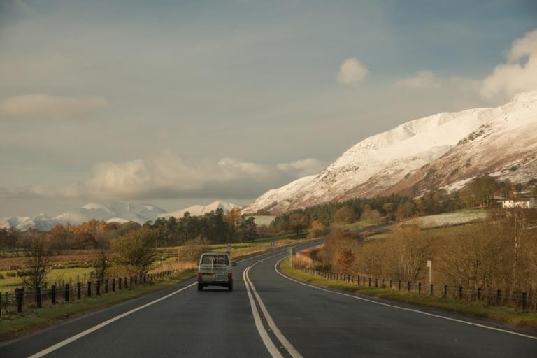 A car driving through mountains near Keswick