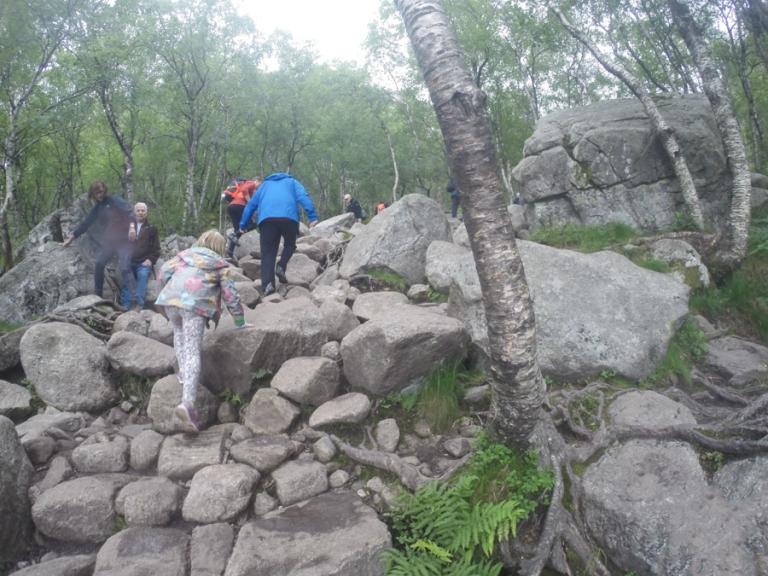Children clambering up rocks in Norway